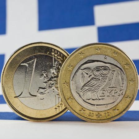 greek coins: Greek 1 Euro coins, Flag of Greece Stock Photo
