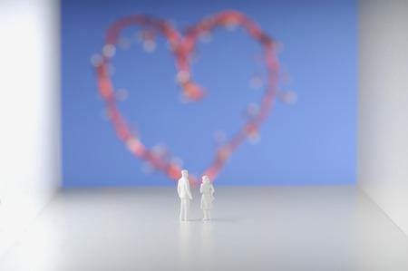 female likeness: Couple standing against heart.