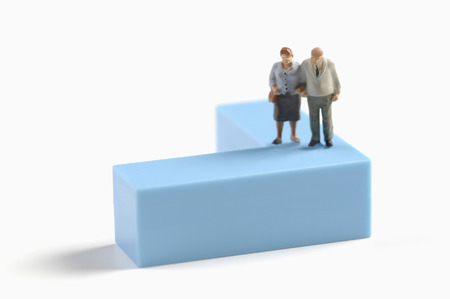 female likeness: Figurines of Senior couple standing on building brick Stock Photo