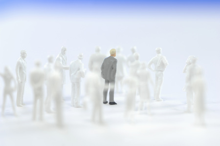Businessman figurine and silhouettes of figurines