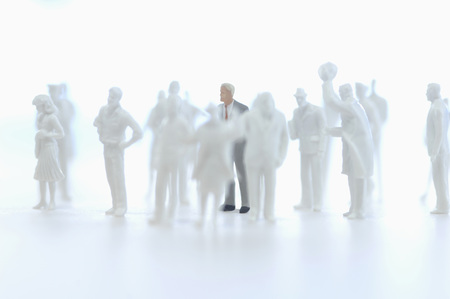 jobholder: Businessman figurine and silhouettes of figurines