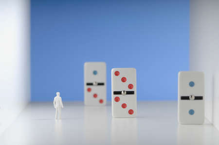 differential focus: Figurine standing in front of domino.