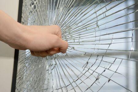 windowpane: Fist demolishing windowpane