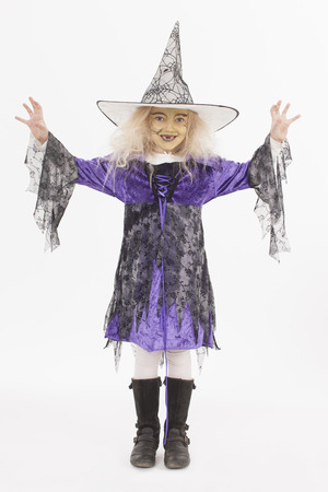 conjuring: Girl in fancy dress costume for halloween