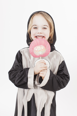 fancy dress: Boy in fancy dress costume with candy, portrait Stock Photo