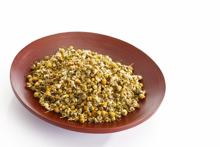 chamomile flower: Dried chamomile flower in a bowl
