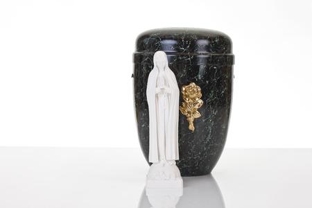 decease: Black urn and saint figure on white background