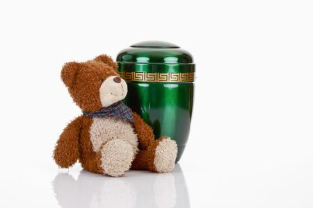 teddybear: Green urn and teddy-bear Stock Photo