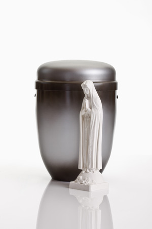 decease: Grey urn and saint figure on white background