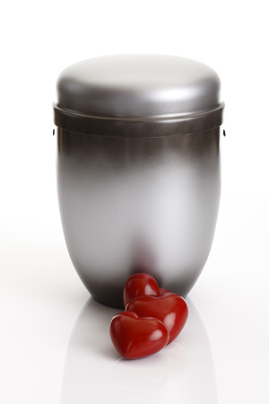 decease: Gray urn and two hearts on white background