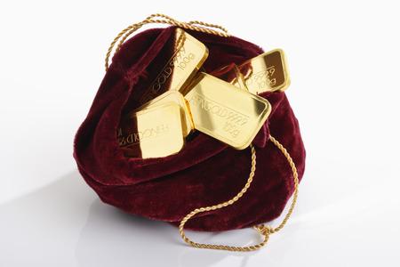 Gold bars in velvet sachet