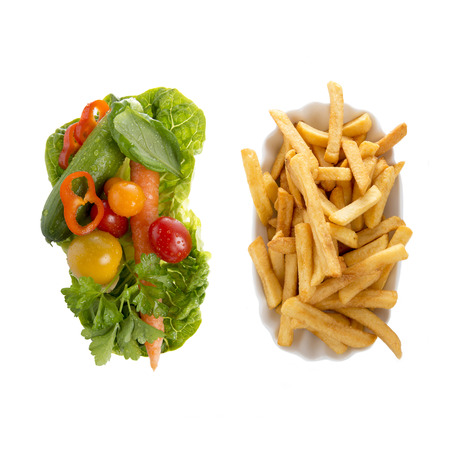 Salad and french fries, healthy and unhealthy eating