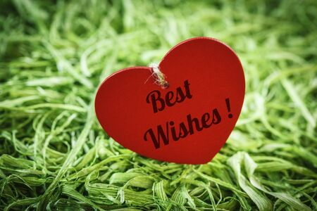 best wishes: Wooden heart on artificial grass, Best wishes