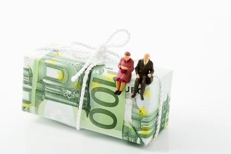 austerity: Senior figurines, 100 Euro note, savings package