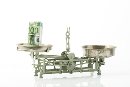frugality: 100 Euro notes on scales