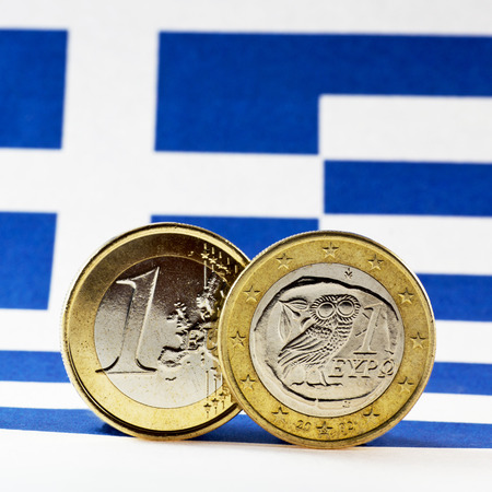 greek coins: Greek 1 Euro coins, Flag of Greece Stock Photo