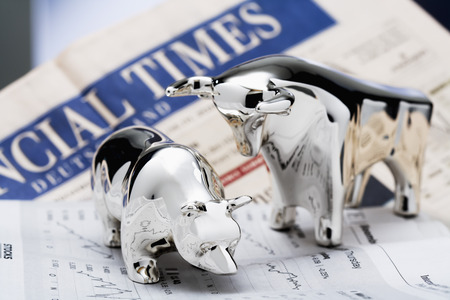 stock market exchange: bull and bear, Financial Times in the background Stock Photo