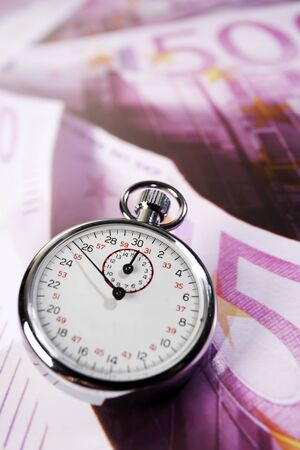 exactitude: Stop watch and 500 Euro notes, time is money Stock Photo