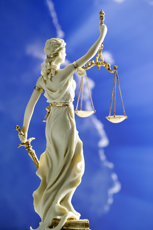 Figurine of justice holding scales
