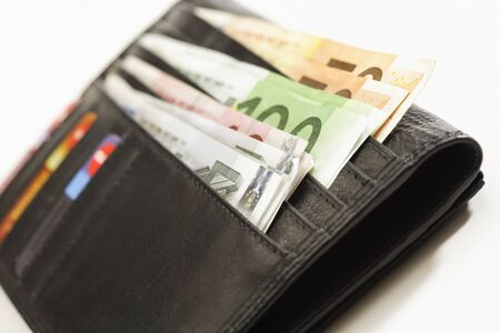 coin purses: Black wallet with euro notes Stock Photo