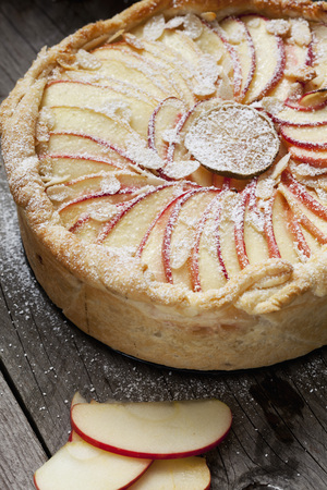 filo pastry: Apple pie baking, filo pastry and slices of apple, icing sugar Stock Photo