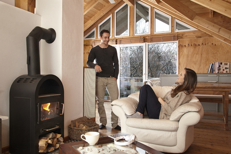 living together: Couple by the fireside