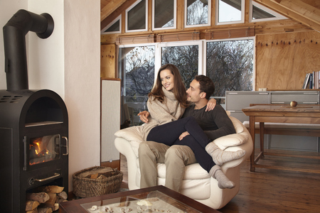 Couple sitting by fireplace