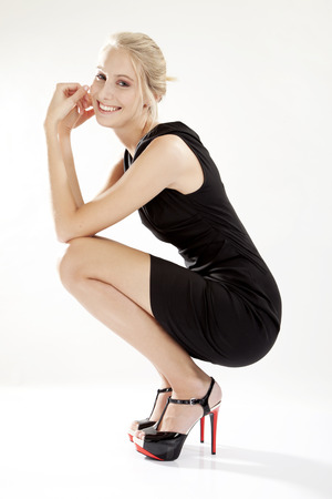 dress shoe: Young woman wearing little black dress, LBD