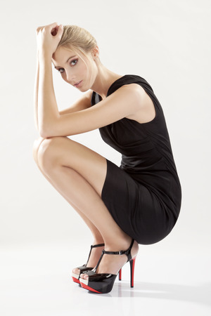 lbd: Young woman wearing little black dress, LBD
