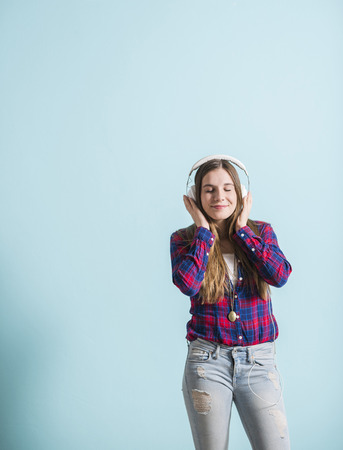rhythmical: Young girl with head phones listening to music