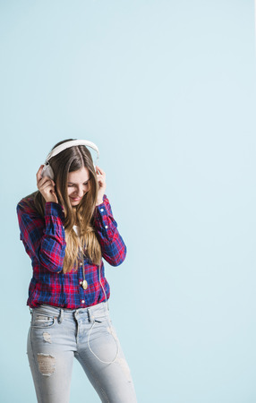 head phones: Young girl with head phones listening to music