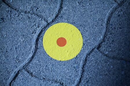 Colorful marking dot on road pavement