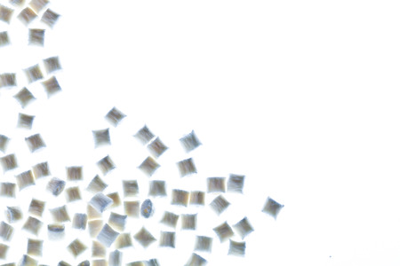 granules: Plastic granules on white background, abstract Stock Photo