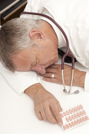 doctor burnout: Overworked doctor having burn out