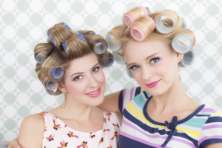 Young women with curlers