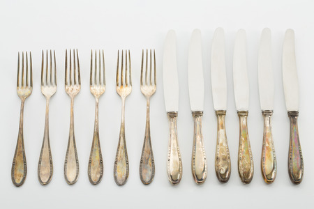 silver cutlery: Old silver cutlery, fork, knife, row Stock Photo