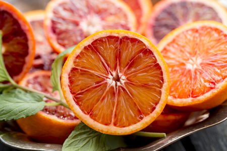 cut and blood: Sliced blood orange Stock Photo