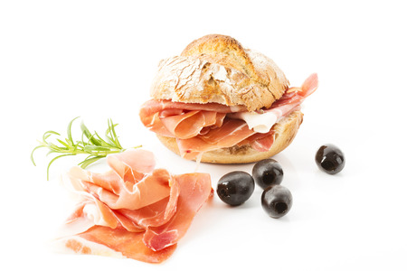 bread roll: Parma ham, bread roll and black olives Stock Photo