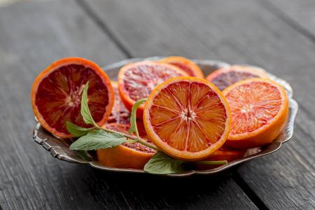 Sliced blood orange on plate