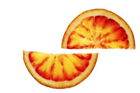 Two slices of blood orange on white background Stock Photo