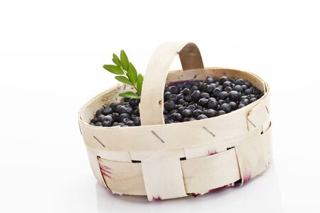 bast basket: Blueberries in bast basket, leaf