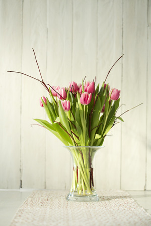 doiley: Bouquet of tulips in vase