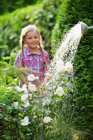twee: Girl watching as flowers being watered