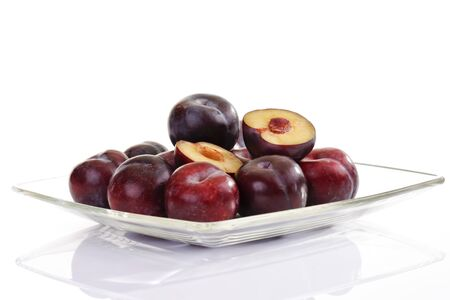 glass bowl: Italian plums on glass bowl