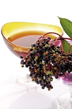 glass bowl: Elder, elderberries, glass bowl with elderberry juice