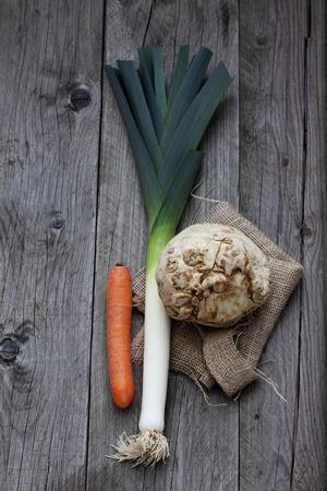 celeriac: Celeriac, carrot and leek, jute on wood Stock Photo