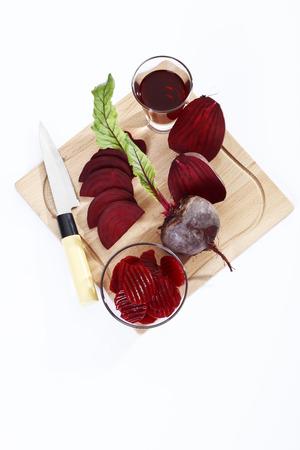 chopping board: Beetroot, beetroot juice, knife on chopping board