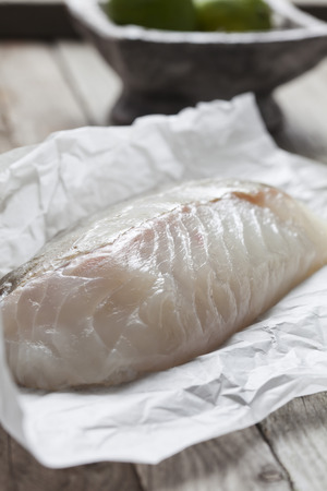fish fillet: Row fish fillet, cod on greaseproof paper