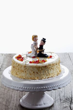 cakestand: Wine cream cake, wedding cake with figurines, bride and groom