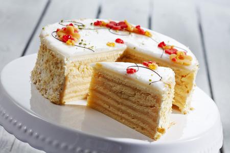 slice of cake: Decorated wine cream cake on cake stand